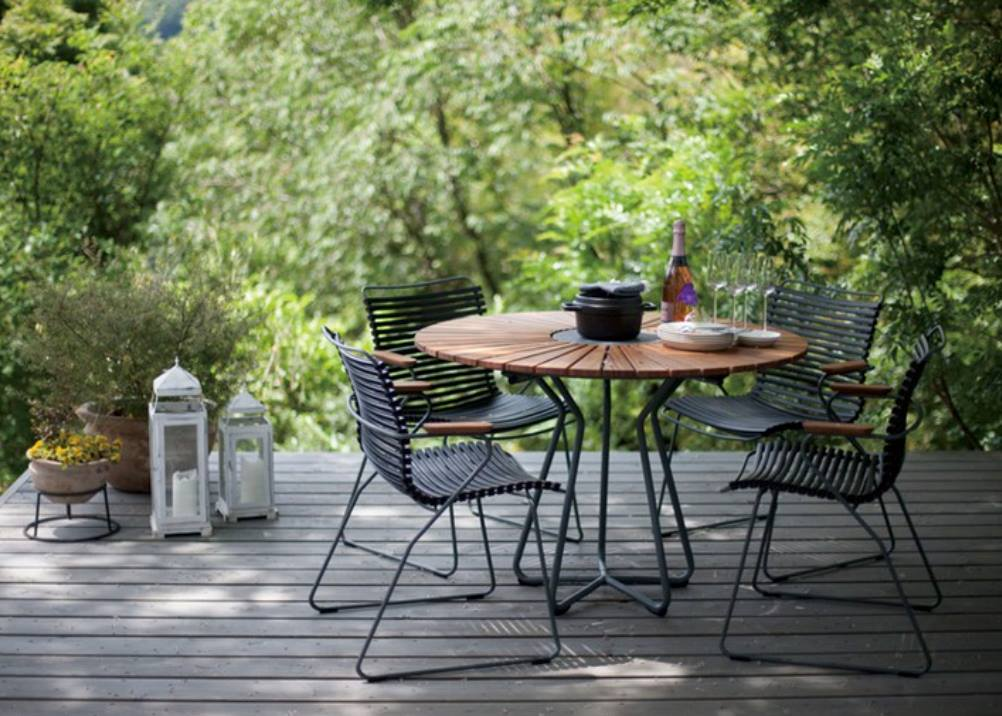 In an outdoor setting the playnk-dining-chairs-with-bamboo-arms