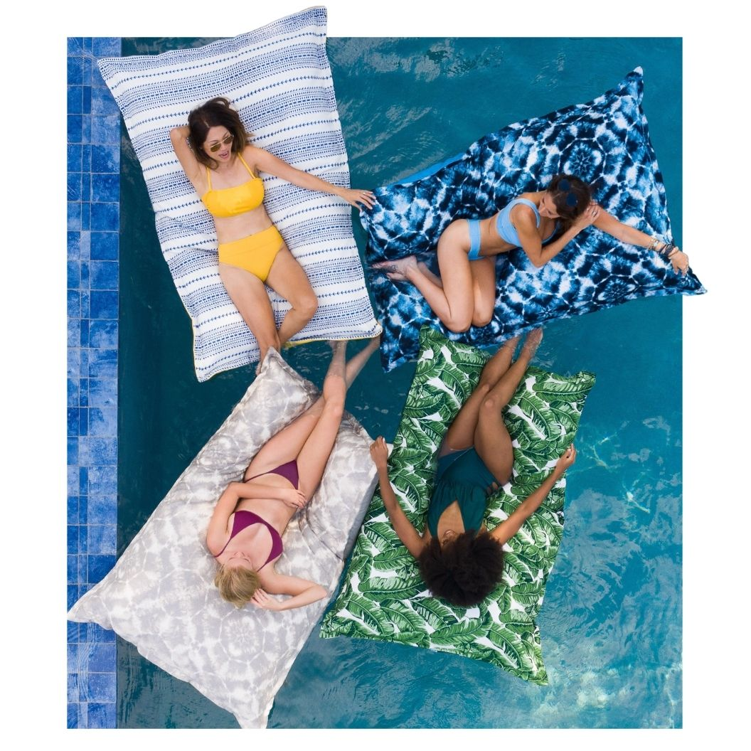 luxury shibori-gray-laze-pillow-float in swimming pool
