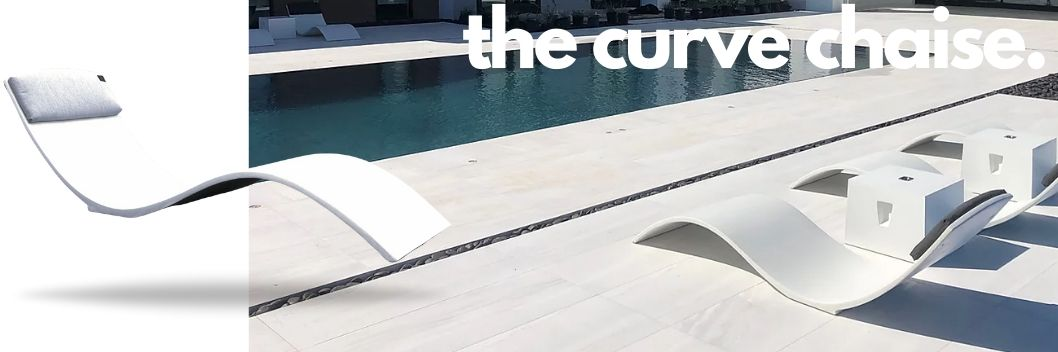 the-curve-in-pool-chaise white