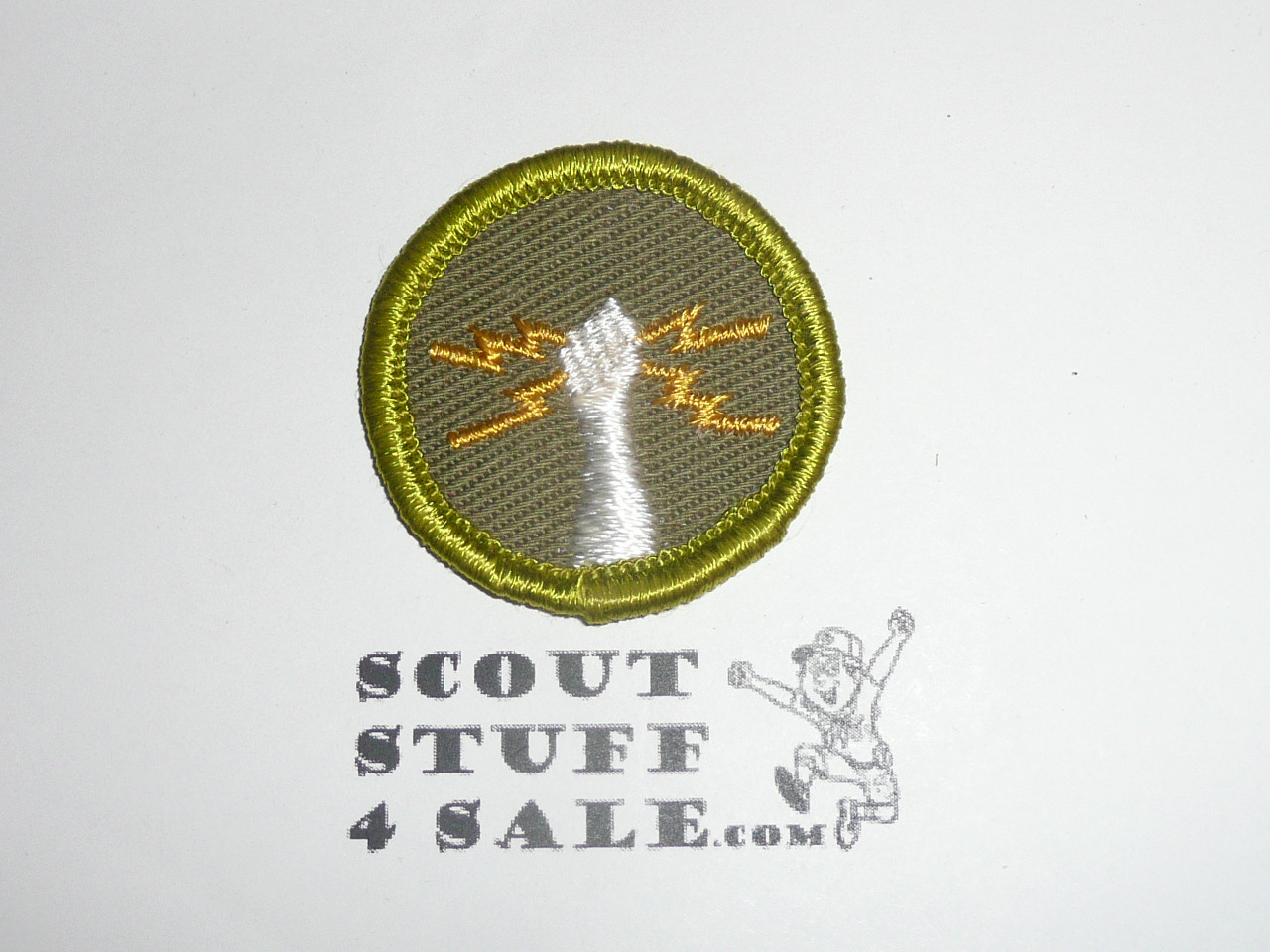 Electricity - Type F - Rolled Edge Twill Merit Badge (1961-1968), with fingers variety