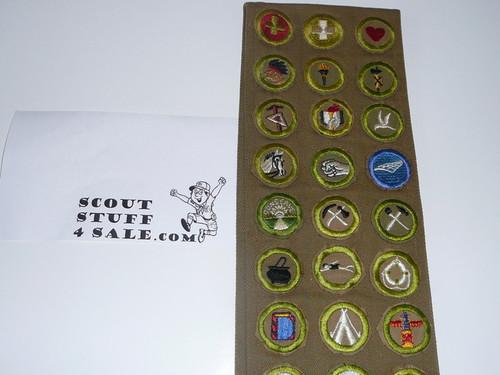 1940's Boy Scout Merit Badge Sash with 37 tan & Khaki crimped merit badges (4 are Air Scout), Air Scout & camp patches