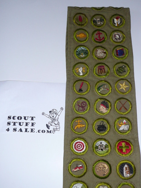 1940's Boy Scout Merit Badge Sash with 61 crimped merit badges.  Includes Soil Mgt, rocks/minerals & cement work.  Also has stalking and taxidermy square cut to round