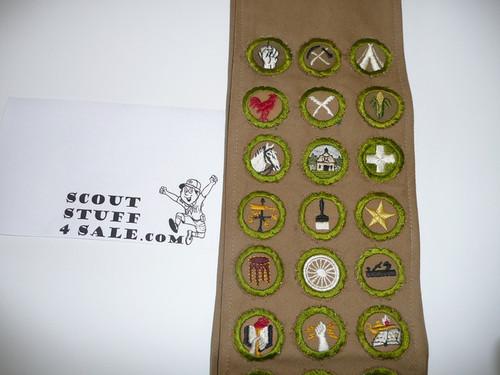 1930's Boy Scout Merit Badge Sash with 36 square merit badges cut to round