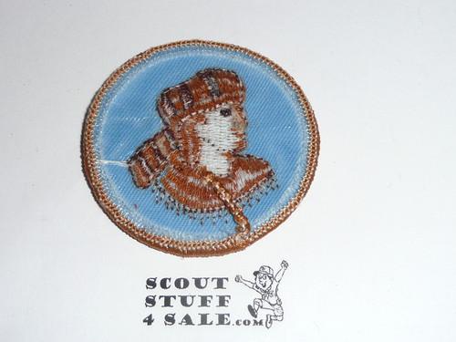 Frontiersman Patrol Medallion, Blue Twill (tan man) with plastic back, 1989-2002