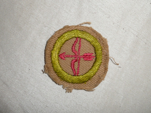 Archery - Type A - Square Tan Merit Badge (1911-1933), Material trimmed and badge used