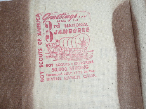 """1953 National Jamboree """"What is a boy"""" article with Jamboree stamps on it and a piece of fabric with the stamp on it"""