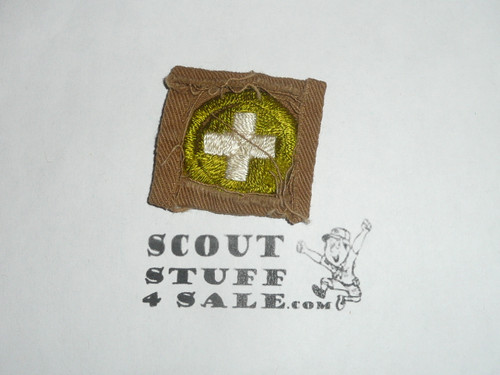 Safety - Type A - Square Tan Merit Badge (1911-1933), lt use, material folded under