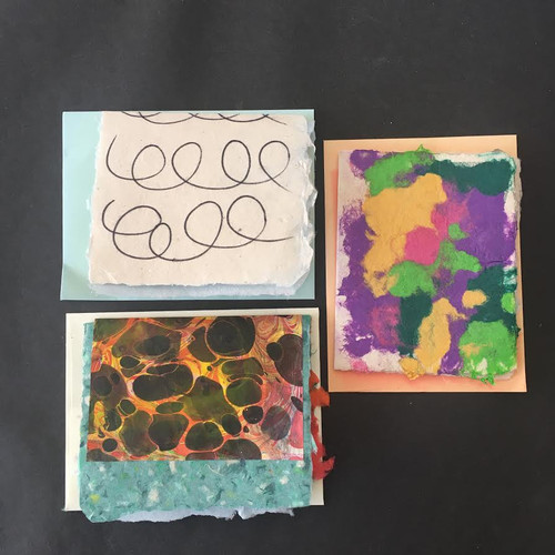 Handmade paper with pulp painting, India ink and marbled paper.