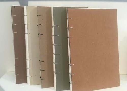 Five sketchbooks we made in studio.