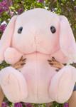 Lifestyle shot of Amuse Pink Bunny Plush Keychain