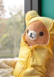 Lifestyle shot of Rilakkuma Yellow Sleeping Bag Plush Stuffed Animal