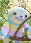 Lifestyle shot of Amuse Rainbow Sloth Medium Plush