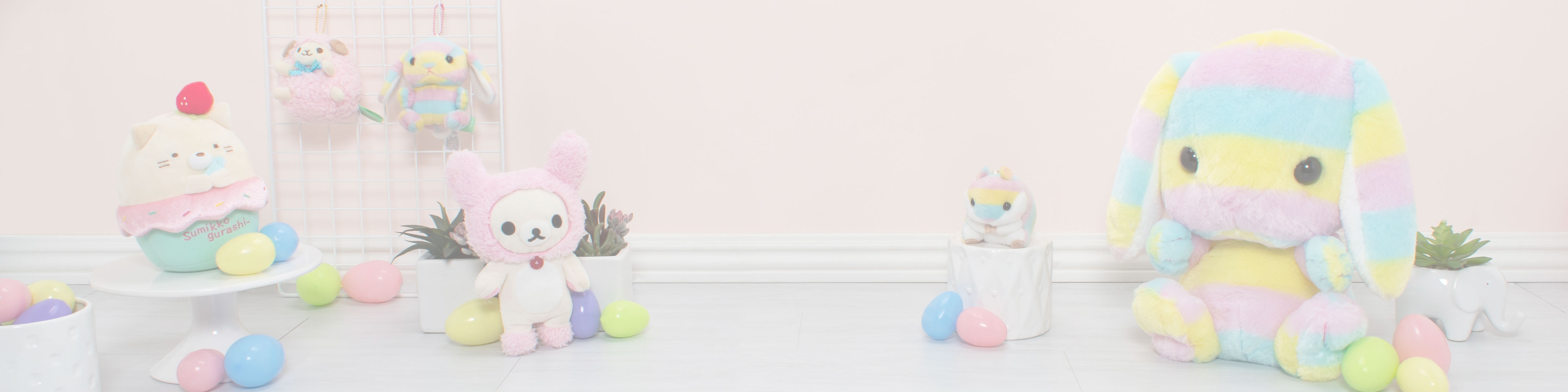 Easter Promo showcasing Amuse rainbow plush and other easter related plush surround by easter eggs.