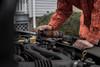 Spraying Rust Patrol Multi-Purpose 7 oz Aerosol Can into car engine compartment