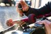 Spraying Rust Patrol Multi-Purpose 2 oz Spray Bottle onto skateboard wheels