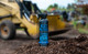 Rust Patrol Heavy Duty 7 oz Aerosol Can with tractor in the background