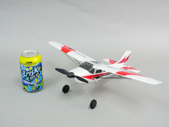 RC Micro Airplane Next to Soda Can