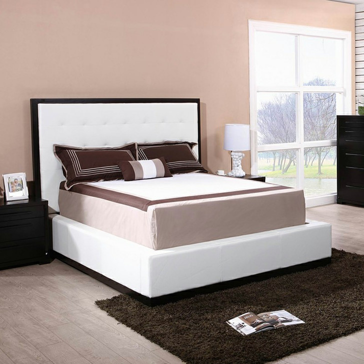 padded platform bed with dark wood and white fabric