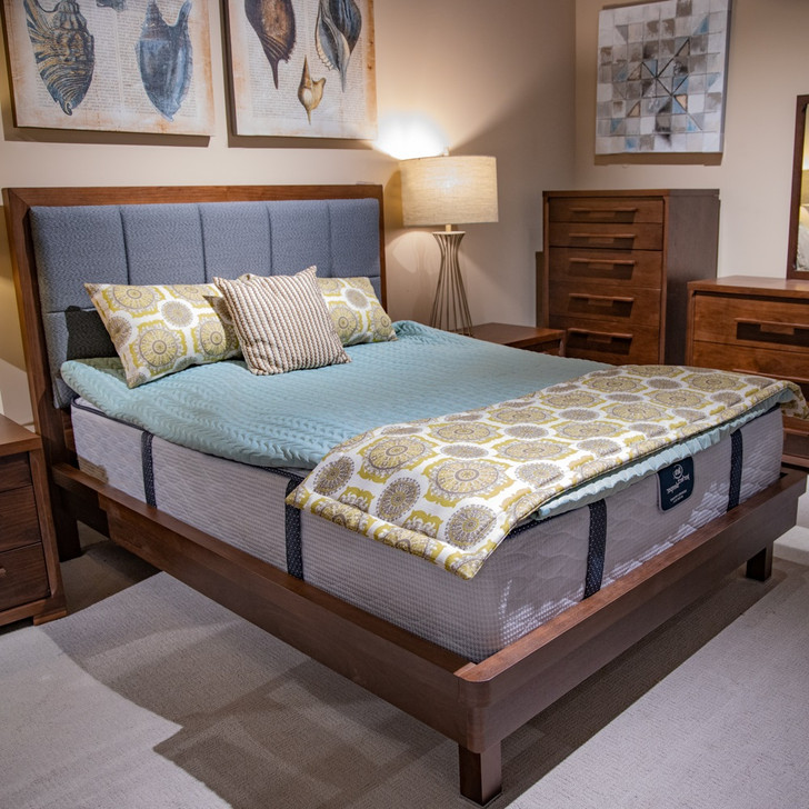 walnut bed with padded upholstered grey headboard