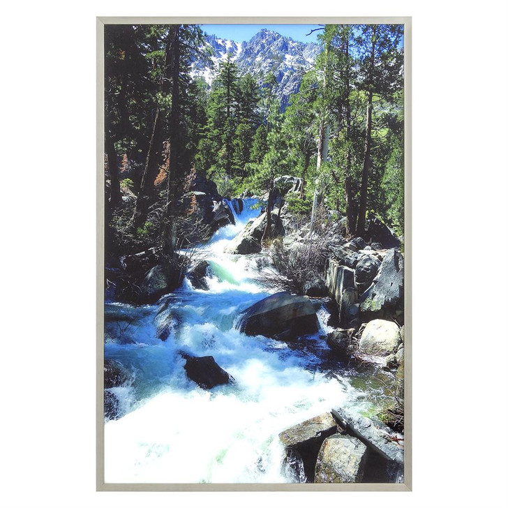 framed image of scene with mountains, river, trees, and rocks