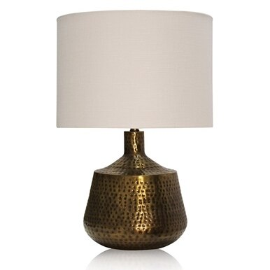 gold hammered base table and desk lamp with a cream lampshade
