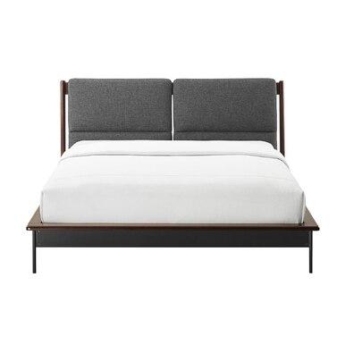 modern bed with a dark wood base and elegant soft grey headboard