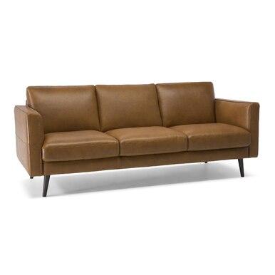 stationary brown natuzzi three-seater sofa