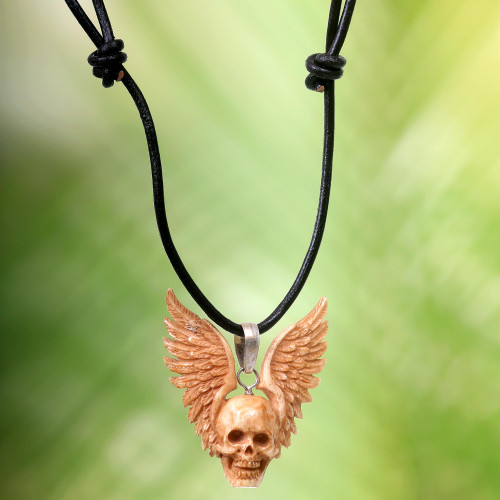 Hand Carved Bone Pendant Necklace of a Skull from Indonesia 'Flying Skull'