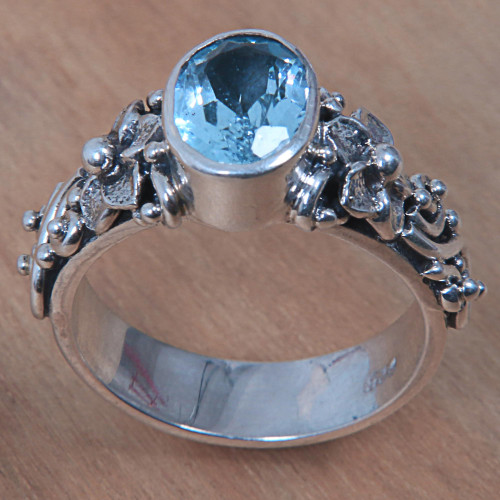 Oval Cut Blue Topaz and Silver Ring with Floral Design 'Frangipani Path'
