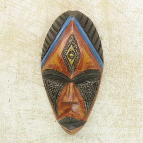 Hand Carved African Sese Wood Mask with Brass Plate 'Jabu'
