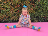 Brooklyn with our Rainbow Knee High Socks in Sunshine Stripes.   Pic credit: https://www.instagram.com/brooklyn.capple/