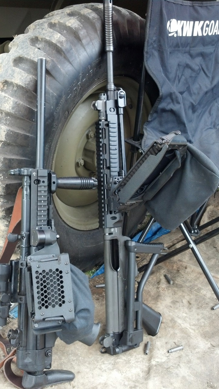 mp5 model on left next to FAL equipped with AK 47 model.