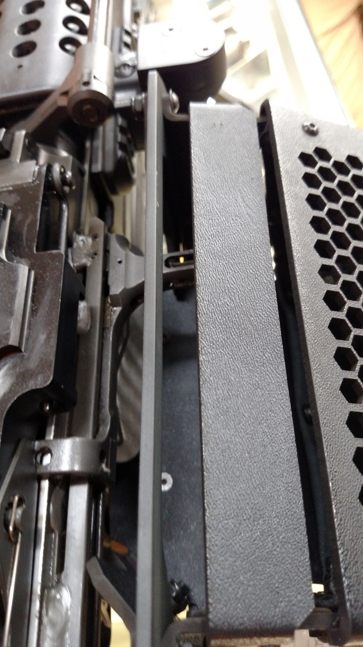 position opening of SAW model brass catcher centered over the ejection port.
