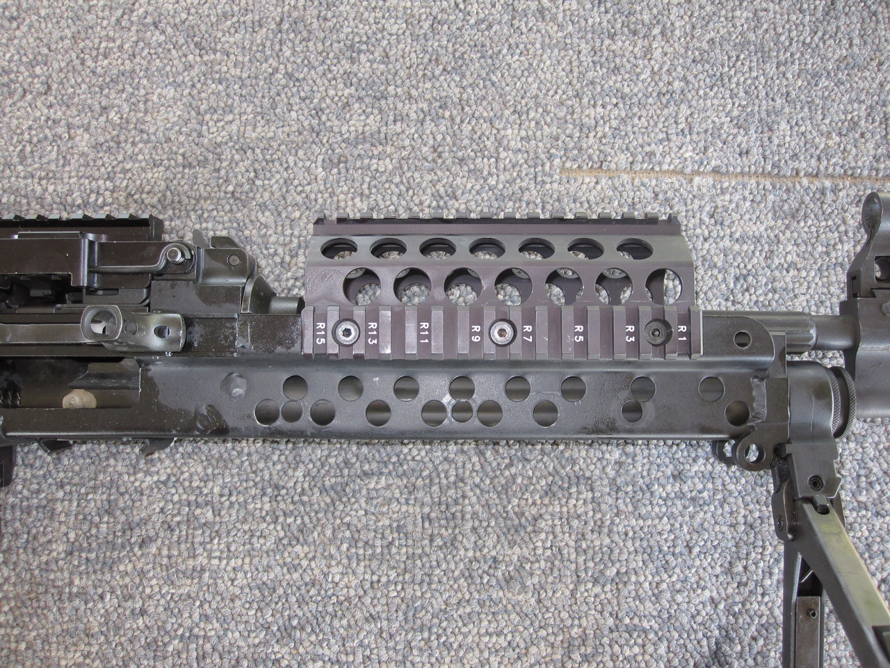 Upper RAS handguard shown on Machine Gun Armory Mk46. Use M249 SAW/MK46 High Rail position (SAWBFG1 High) with this handguard.