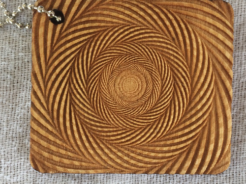 Coils Optical Illusion birch laser cut keychain