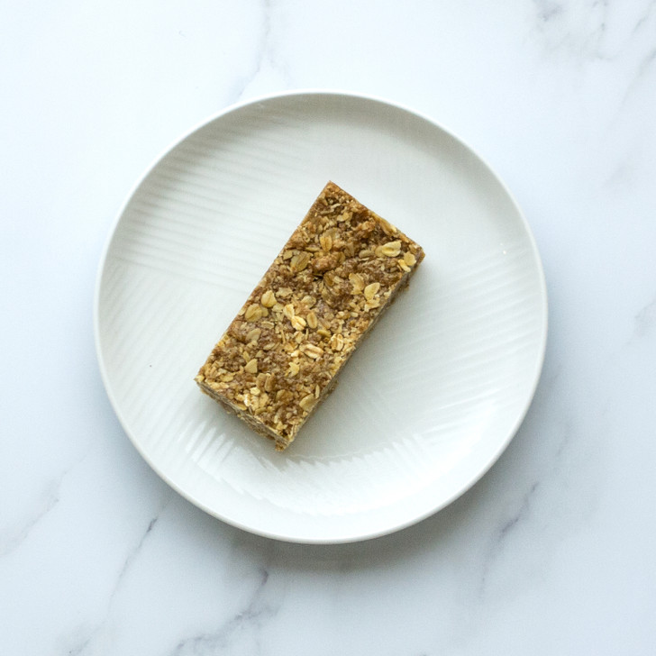 One classic gluten free flapjack on white plate