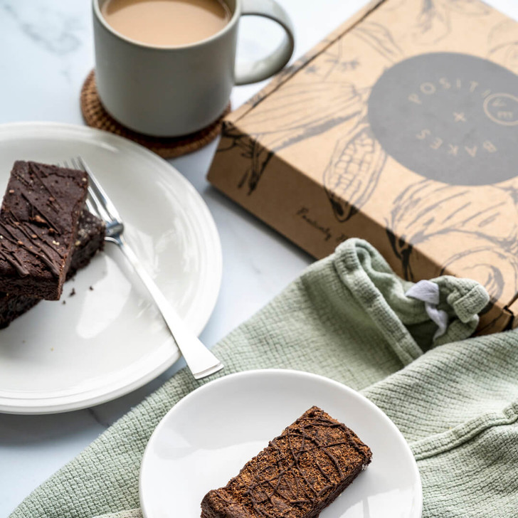 Dairy free brownies laid out with coffee