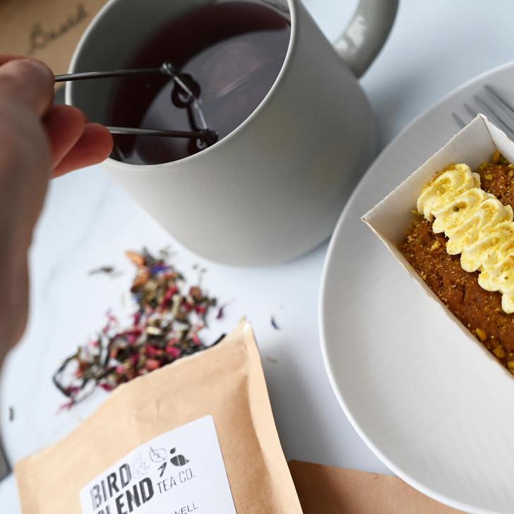 Mug of tea and mini vegan carrot cake