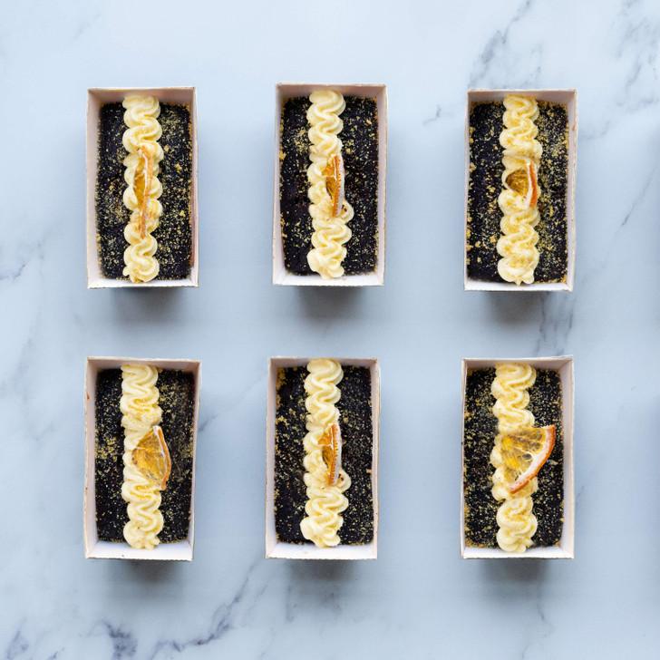 Six chocolate and orange vegan cakes in mini loaf cases