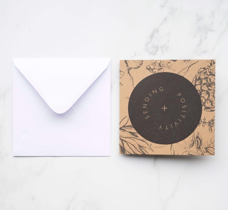 "Sending Positivity square card with dark green illustration over craft background saying ""Sending Positivity"""