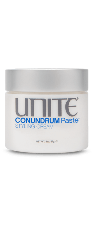 Wax, paste or cream?CONUNDRUM Paste™makes the answer easy… all the above. This styling cream boasts the benefits of a wax, paste, and cream, all in one magical pot! Create a flexible hold that's messy, sleek or anything in between, and it will last all day. Use on wet or dry hair.  BENEFITS  Moldable manipulation Thermal protection Works on all hair types On wet hair, gives a natural finish with separation On dry hair, gives a matte finish with separation and stronger hold  HOLD FACTOR:Wet |4Dry |5(scale 1 – 10)  BEST RESULTS  Rub a small amount of CONUNDRUM Paste™ between your palms and work through damp or dry hair.