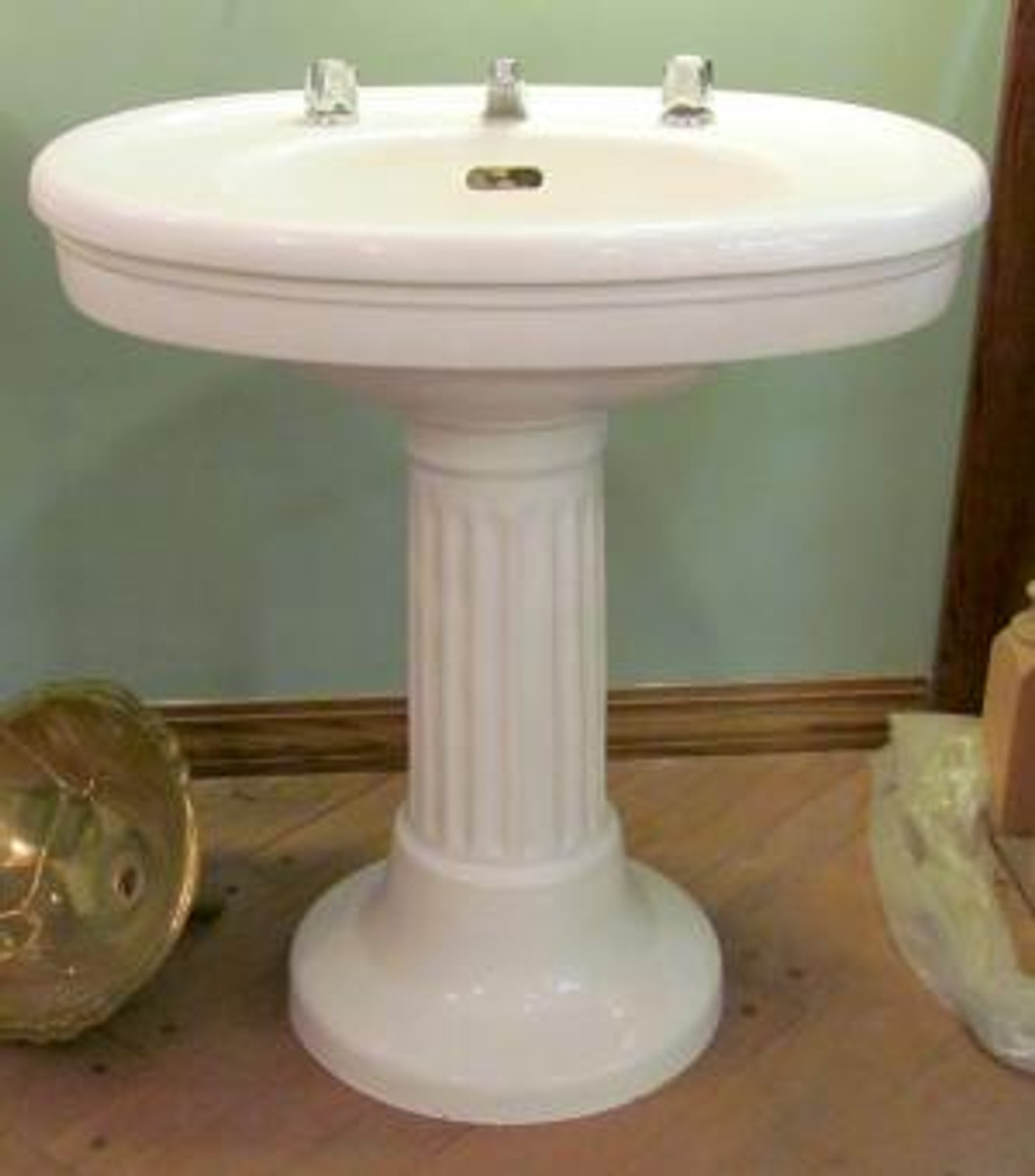 """Gorgeous Colonial Revival Style vitreous china oval topped pedestal sink  made by """"SESCO"""" featuring a fluted column pedestal."""