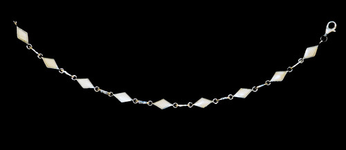 "This trendy round mammoth ivory is inlayed into an elegant diamond shaped sterling silver bracelet.  The dimension of the bracelet is approximately 6.72"" x .25""."