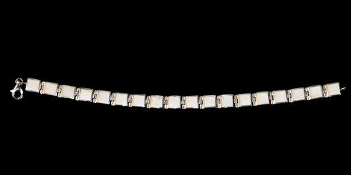 "This trendy mammoth ivory is inlayed into an elegant square shaped shaped sterling silver bracelet.  The dimension of the bracelet is approximately 7"" x .186""."