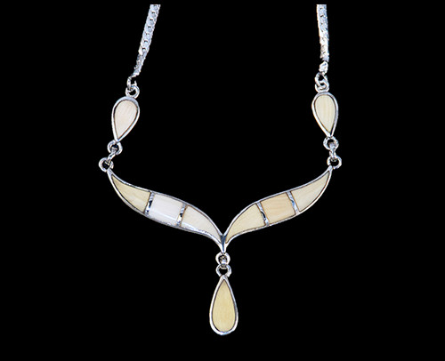 "This unique whale tail with Teardrop Mammoth ivory shaped whale tail is inlayed into a sterling silver pendant.  This pendant comes with an 18"" Sterling Silver chain.  The dimensions of the mammoth pendant tusk is approximately 2.25"" x 1.7""."