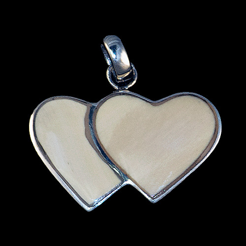 "This beautiful large double heart shaped mammoth ivory tusk is inlayed into a sterling silver pendant.  This pendant comes with an 18"" Sterling Silver chain.  The dimensions of the mammoth pendant tusk is approximately .92"" x 1.61""."