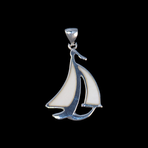 "This stunning sail boat shape is inlayed into a sterling silver pendant.  This pendant comes with an 18"" Sterling Silver chain.  The dimensions of the mammoth pendant tusk is approximately 1.10"" .72""."