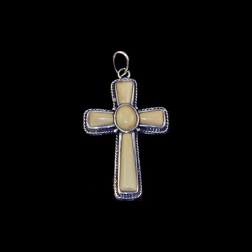 "This striking large cross shaped mammoth tusk piece is inlayed into a sterling silver pendant.  This pendant comes with an 18"" Sterling Silver chain.  The dimensions of the mammoth pendant tusk is approximately 1.23"" x .79""."