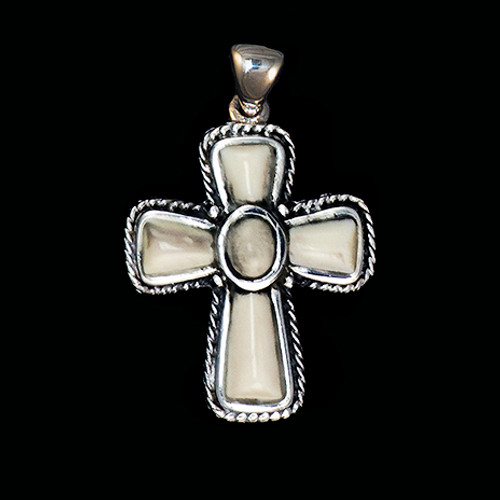 """This graceful small cross shaped mammoth tusk piece is inlayed into a sterling silver pendant. This pendant comes with an 18"""" Sterling Silver chain. The dimensions of themammoth pendant tusk is approximately .87"""" x .63""""."""