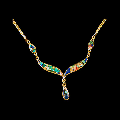 "This unique whale tail with Teardrop Mammoth Northern Lights shaped whale tail is inlayed into a 14K Gold pendant.  This pendant comes with an 18"" 14K Gold chain.  The dimensions of the Northern Light pendant is approximately 2.25"" x 1.7"".  The product id # is PNL-1008-G."